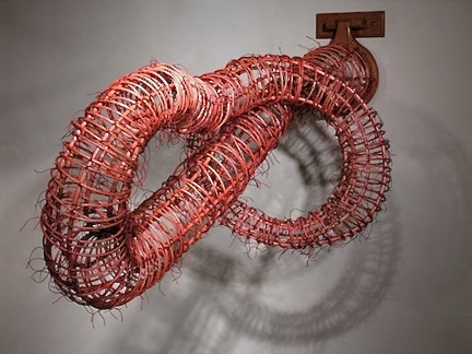 "Figure 8/Infinity ©2011, Reed, wood, waxed linen, wood stain, 21"" x 16"" x 43"""