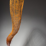 "Yellow Orange Pod ©1999, Reed, waxed linen, cedar, wood stain, 37"" x 11"" x 10"""