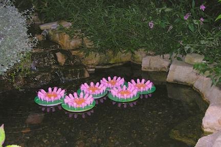 "Floating Flowers 2010, acrylic nails, plastic toy shoes, plexiglas, waxed linen, nail enamel, each piece 4""h x 11.5"" diameter"