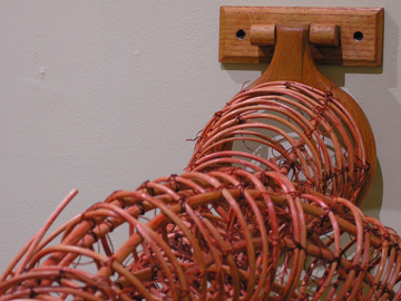 "Figure 8/Infinity ©2011, Reed, wood, waxed linen, 21"" x 16"" x 43"""